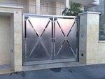 изработка на портална врата от инокс