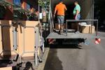 транспорт на товар чрез качване и сваляне на товари с камион
